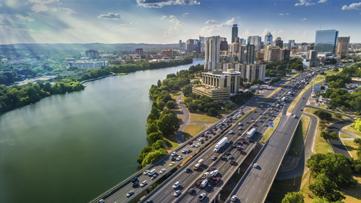 Sunrays paint the Austin Skyline as rush hour traffic picks up on I-35.